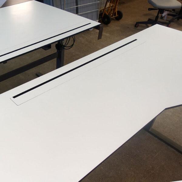 Begagnade Högersvängda elbord 200x100 cm